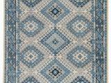 Artemis Blue orange area Rug Hobbs Geometric Rug In Dusty Blue & Blue Heaven Design by