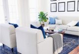 Blue and White Rug Living Room Coastal Living Room Design with White sofa and Blue Rug