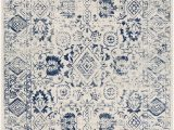 Blue Print area Rugs Covered In A Mix Of Floral and Geometric Patterns This