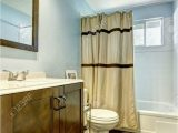 Brown and Blue Bathroom Rugs Bathroom with Brown Tile Floor and Light Blue Walls Wooden Brown