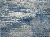 Citium Blue area Rug Trent Austin Design Baldwin Park Abstract Navy Ivory area Rug