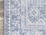 Living Spaces Blue Rug Factoria Serrated Emblem Blue Rug In 2020 Rugs Blue Rug