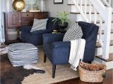 Navy Blue Cowhide Rug Living Room with Abstract Art Navy Chairs Jute Rug & Faux