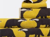 Yellow Bath towels and Rugs Anorak Kissing Badgers towels